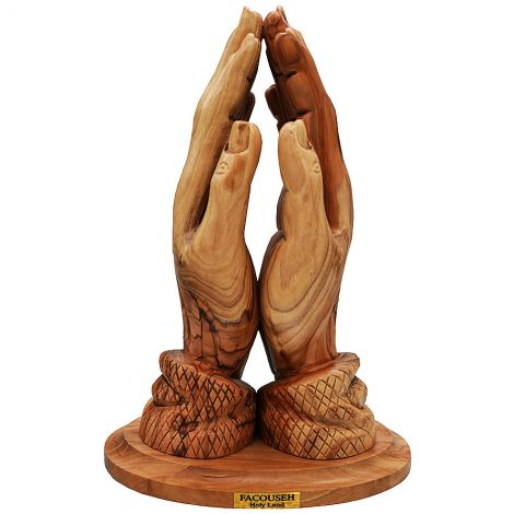 Statue Of The Praying Hand Out Of Olive Wood